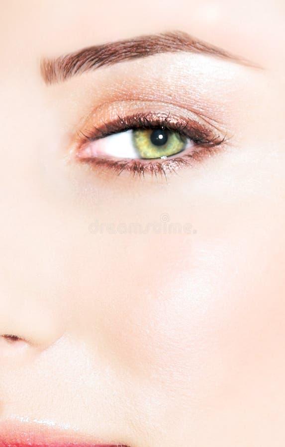 Olho verde de uma mulher imagens de stock royalty free