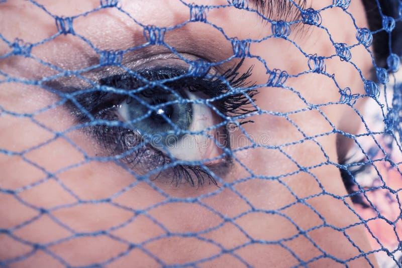 Olhos azuis da mulher nova fotos de stock royalty free