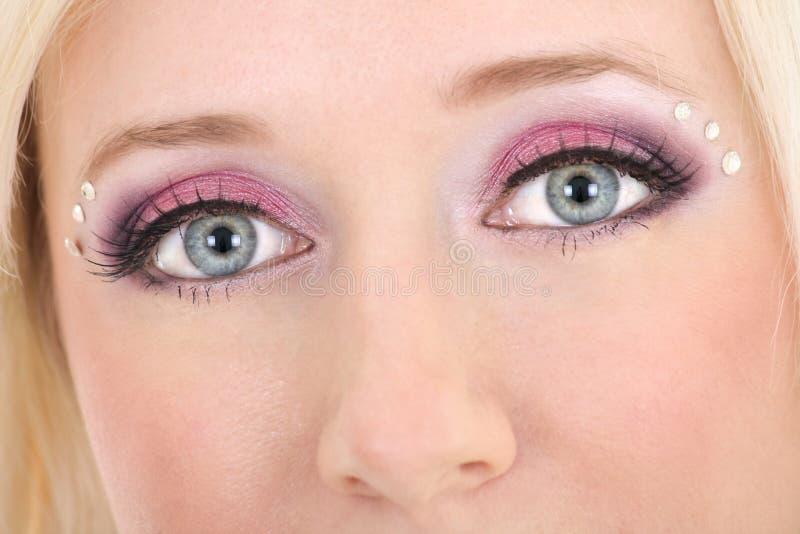 Olhos da mulher com composição creativa imagens de stock royalty free