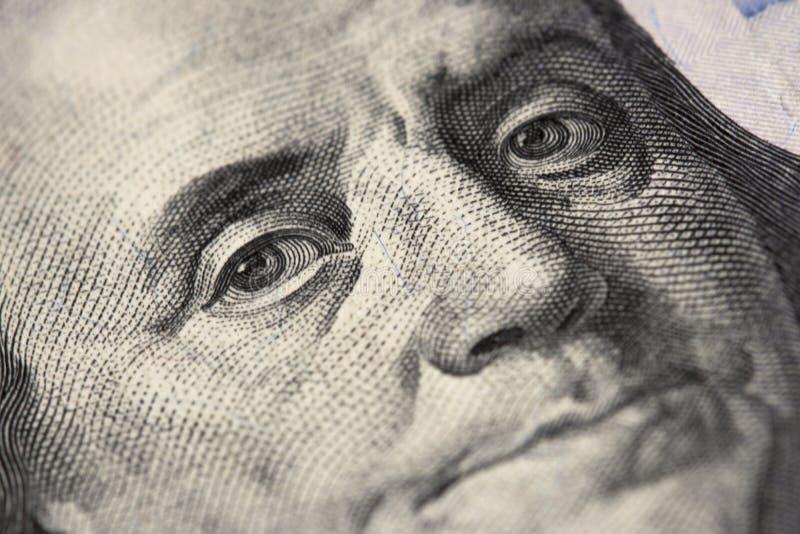 Olhos da nota de dólar nova do americano 100, 100 fanfarrões, cem E.U. imagem de stock