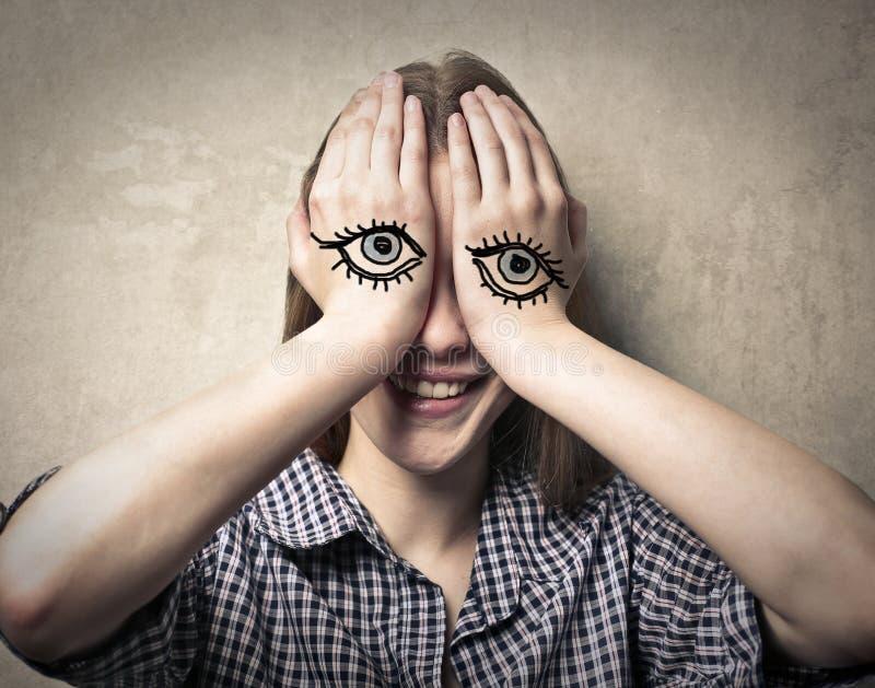 Olhos nas mãos ilustração do vetor