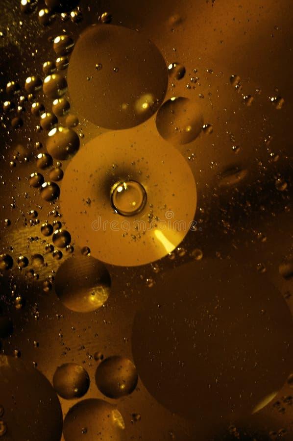 Olie en watercirkels stock afbeelding