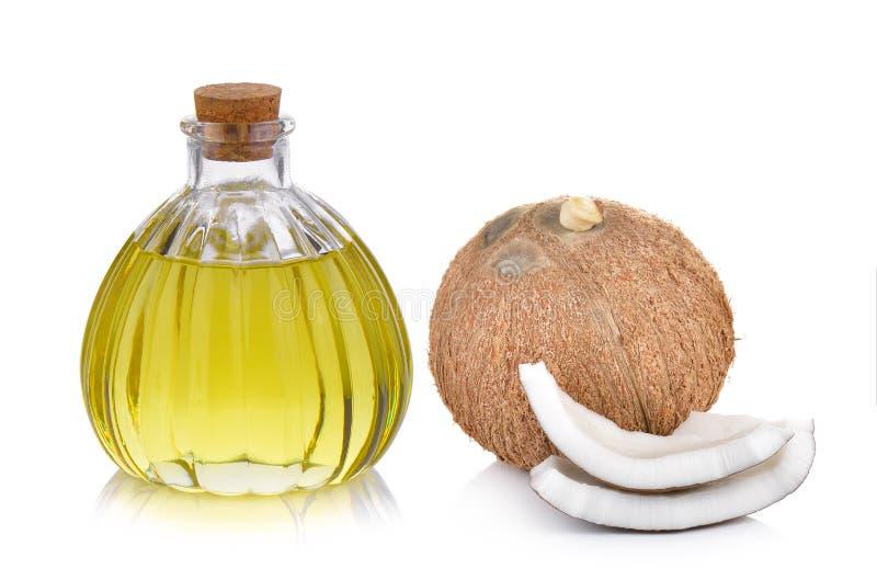 Oliefles en kokosnoot op witte achtergrond stock fotografie