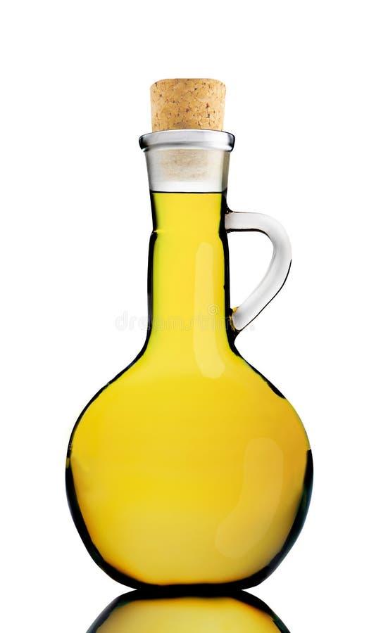 Olijfolie in een ronde fles stock foto's