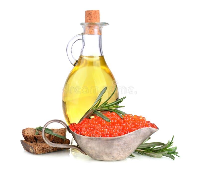 Olijfolie en rode kaviaar stock afbeeldingen