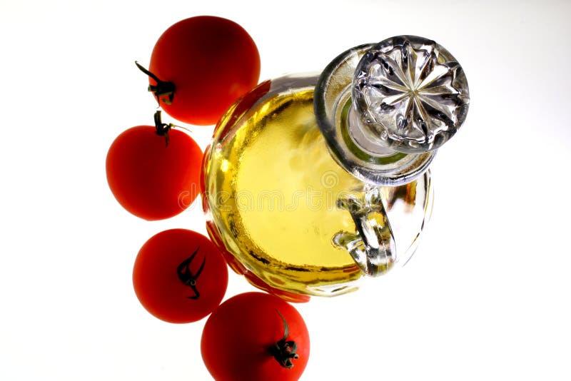 Olijfolie en Tomaten royalty-vrije stock afbeelding