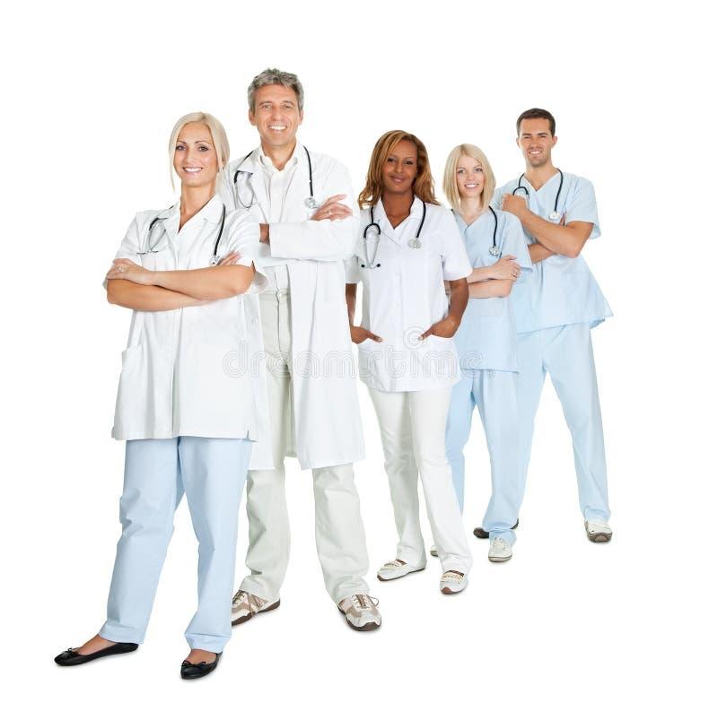 Olik grupp av doktorer som isoleras på vit royaltyfri fotografi