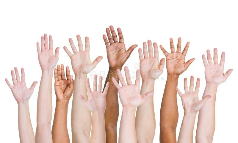 Olik grupp av händer som lyfts upp royaltyfria bilder
