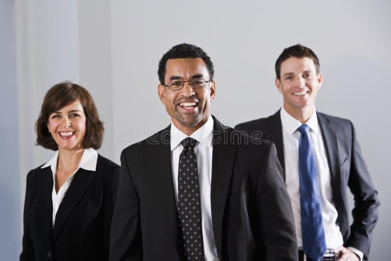 olika dräkter för businesspeople arkivbilder
