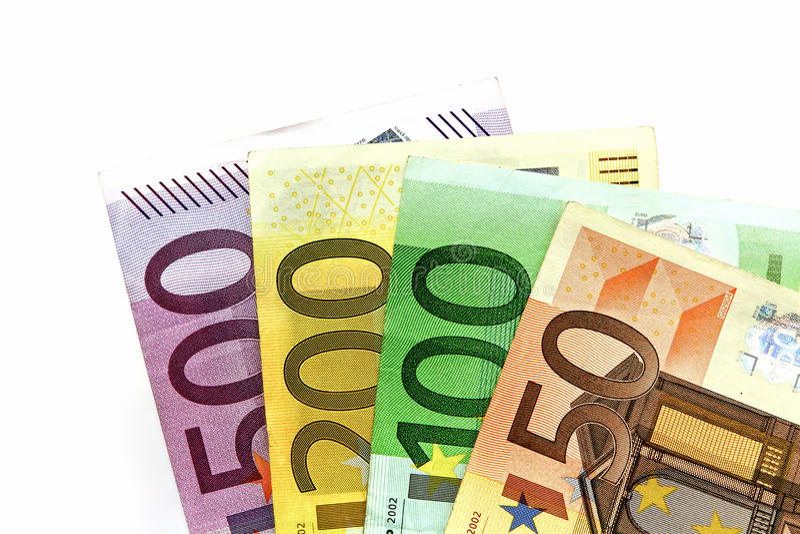 Olika eurosedlar som ordnas på en tabell royaltyfri foto