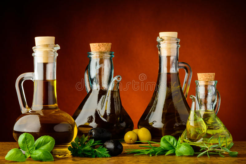 Olika flaskor av ingiven olivolja royaltyfri fotografi