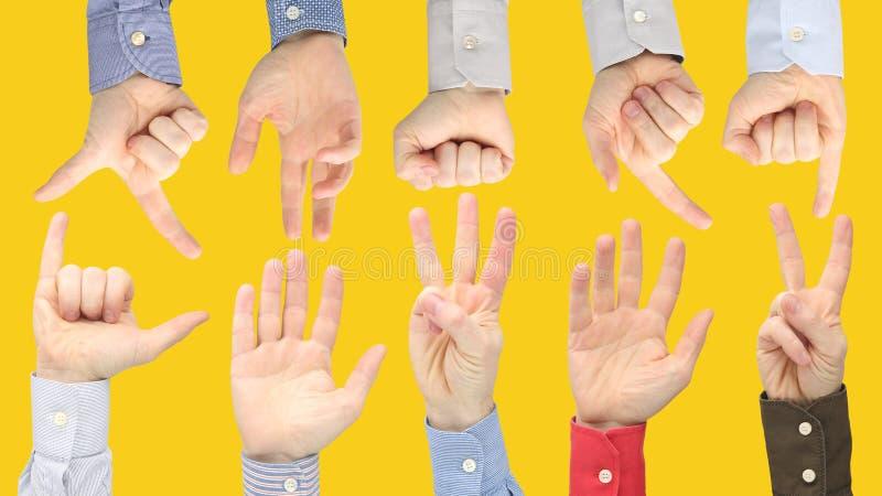 Olika gester av manliga händer mellan de på en gul bakgrund arkivfoto
