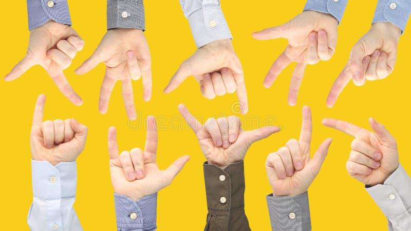 Olika gester av manliga h?nder mellan de p? en gul bakgrund arkivfoton