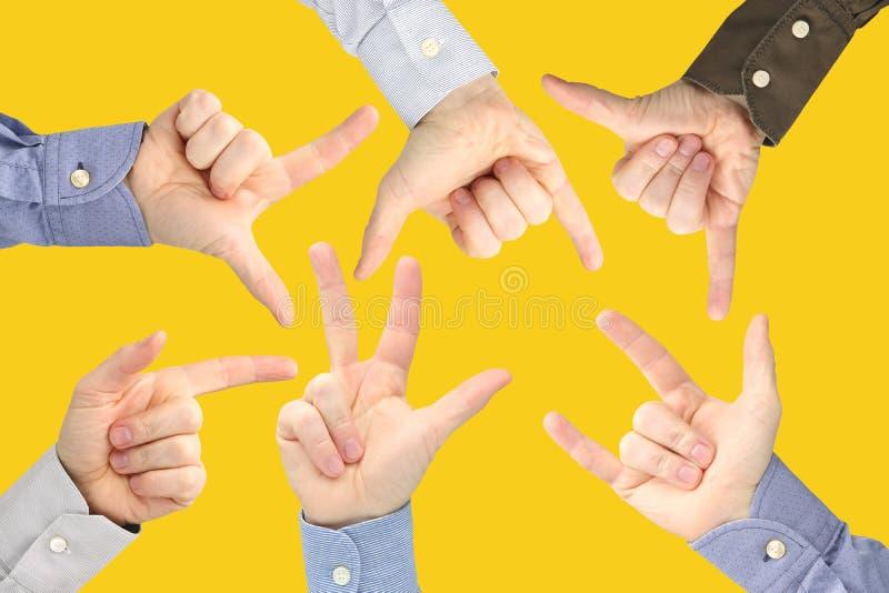 Olika gester av manliga h?nder mellan de p? en gul bakgrund royaltyfria foton