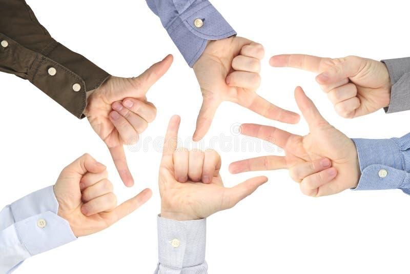 Olika gester av manliga h?nder mellan de p? en vit bakgrund arkivfoto