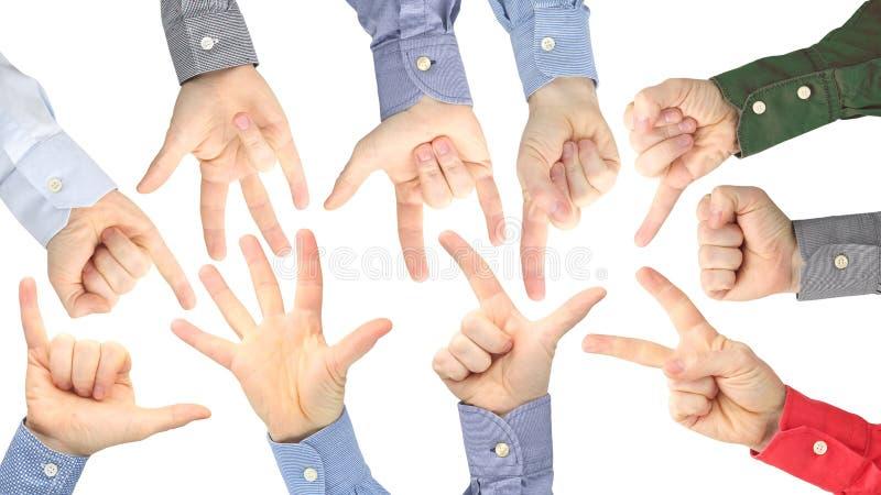 Olika gester av manliga h?nder mellan de p? en vit bakgrund royaltyfria foton
