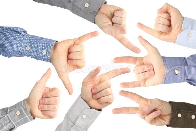 Olika gester av manliga h?nder mellan de p? en vit bakgrund royaltyfri bild