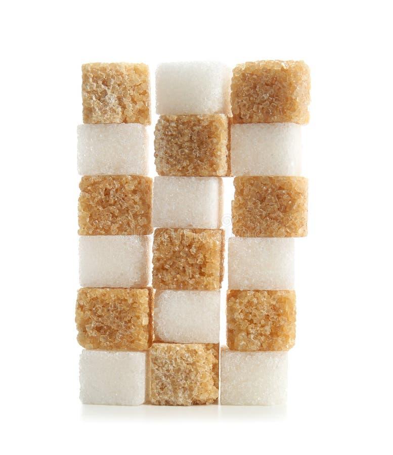 Olika kuber av socker på vit bakgrund royaltyfri foto
