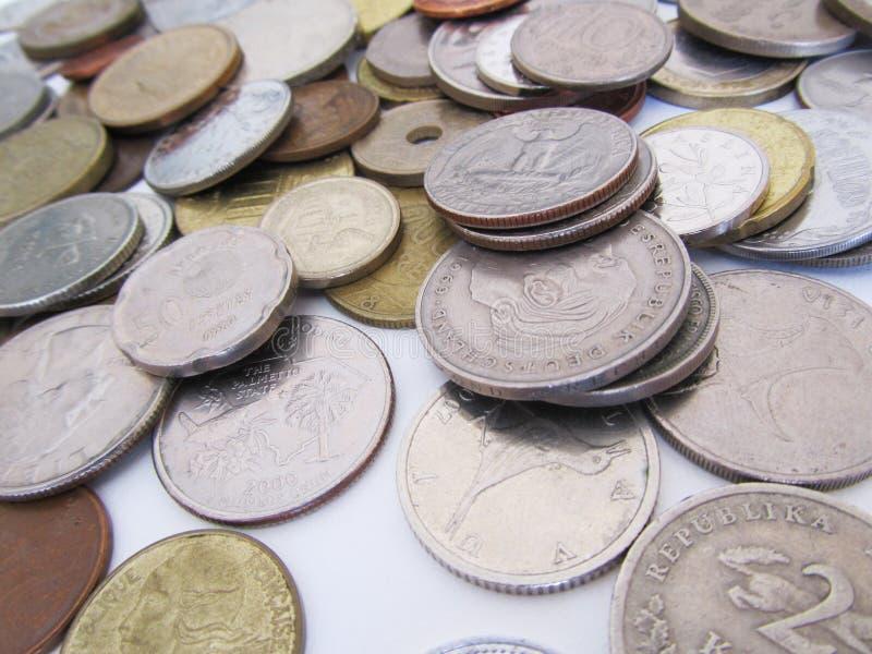 Olika mynt från olika länder royaltyfria foton