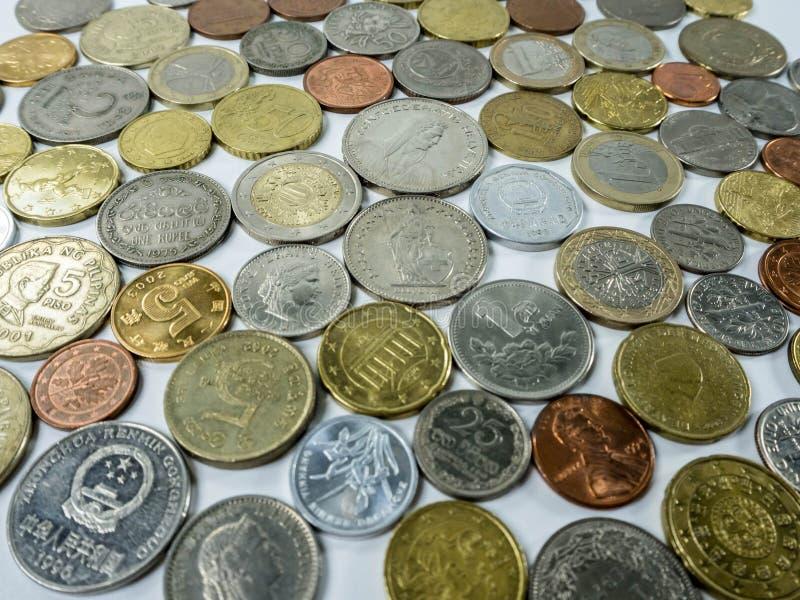 Olika mynttyper på vit bakgrund royaltyfri foto