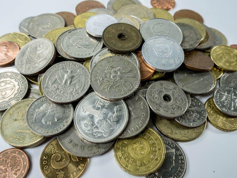 Olika mynttyper på vit bakgrund royaltyfria bilder
