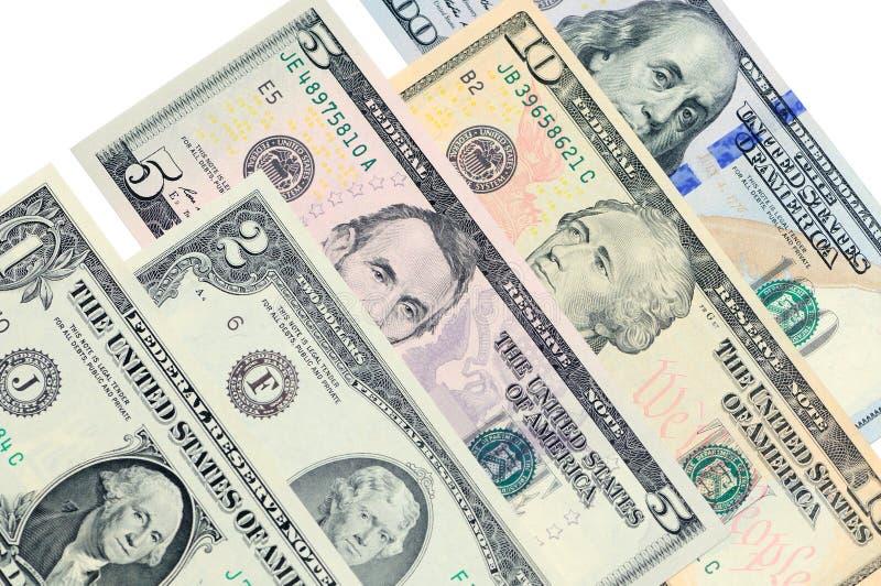 Olika sedlar av US dollarlögn en på andra royaltyfria foton