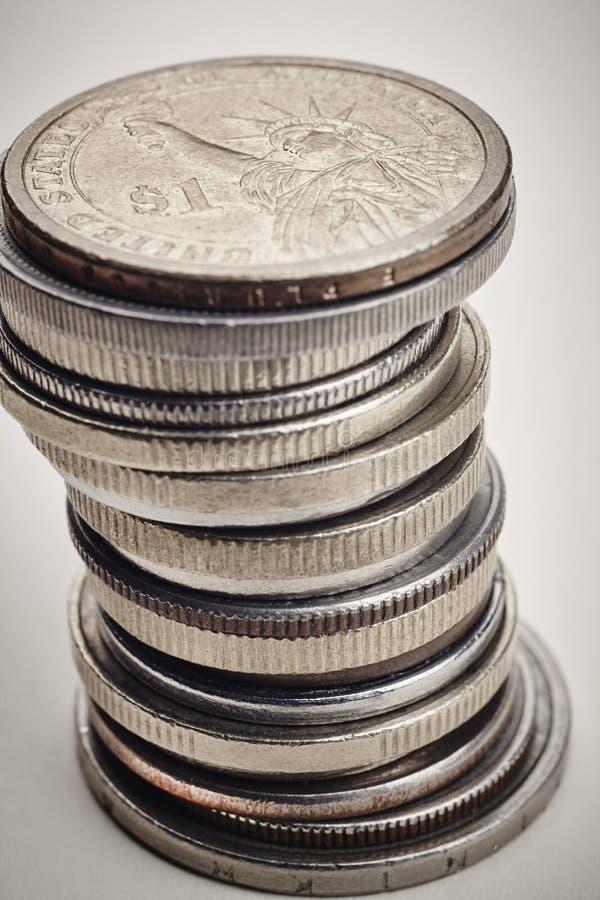 Olika sorter av mynt över en vit bakgrund Makrodetalj royaltyfri foto