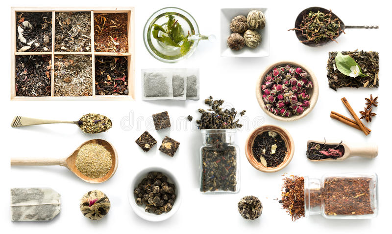 Olika sorter av te, lantlig dishware, kanel, topview royaltyfri fotografi