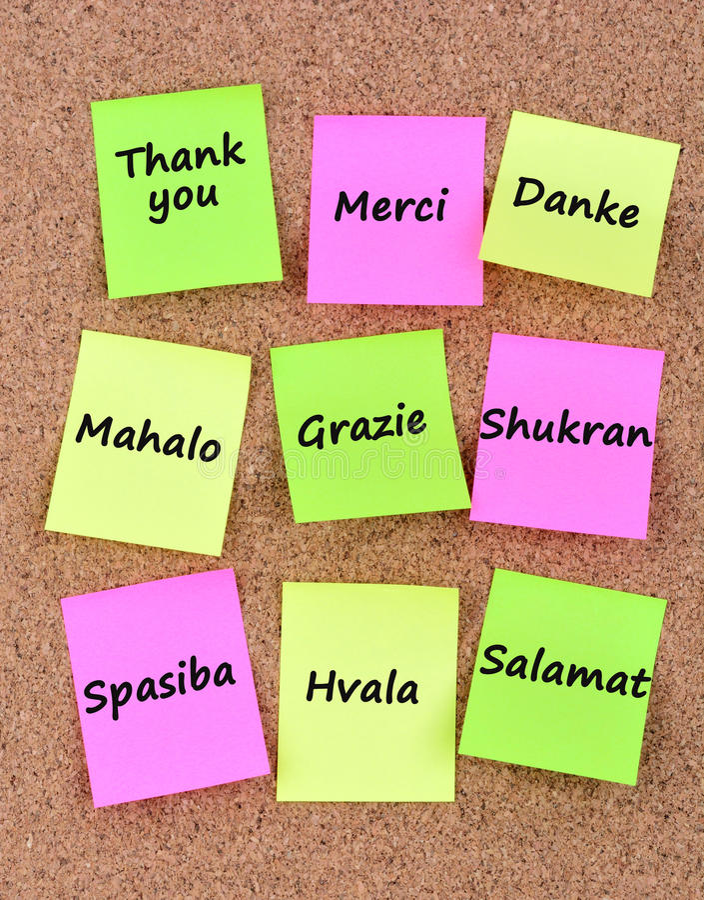 olika språk tackar dig royaltyfri bild