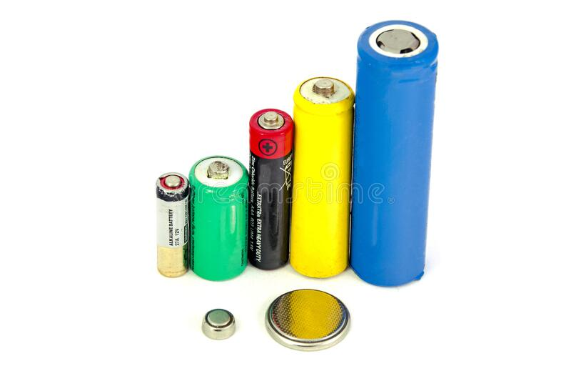Olika typer av batterier och ackumulatorer färg på vit bakgrund, isolerade fotografering för bildbyråer