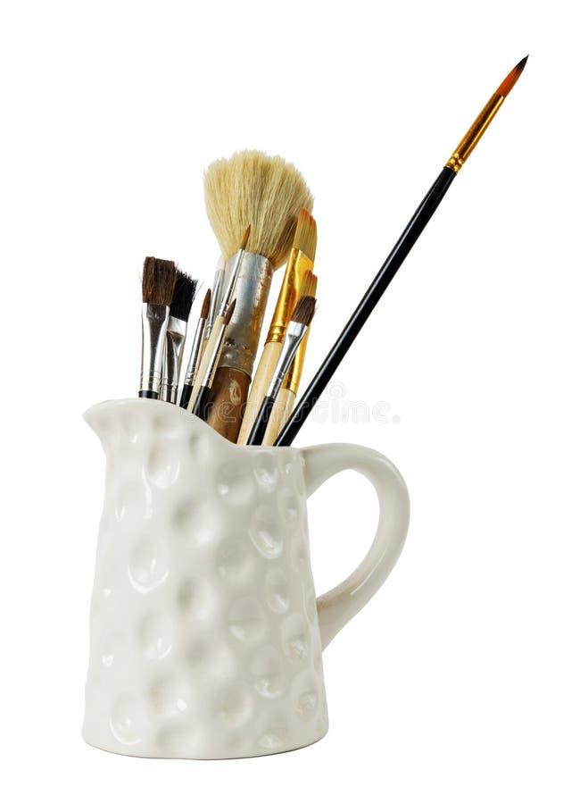 Olika yrkesmässiga målarfärgborstar arkivfoton