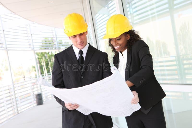 olikt lag för affärskonstruktion arkivbilder