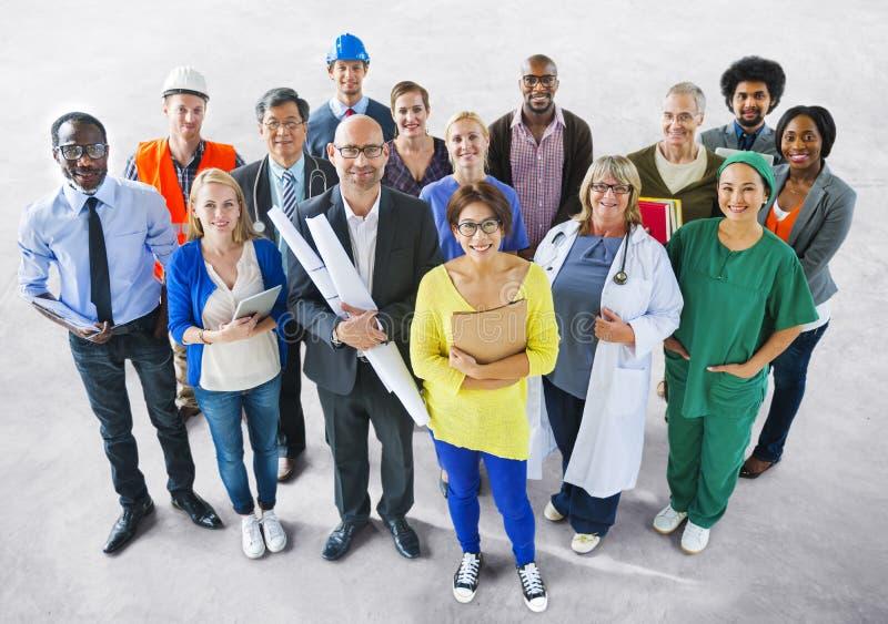 Olikt multietniskt folk med olika jobb royaltyfri foto