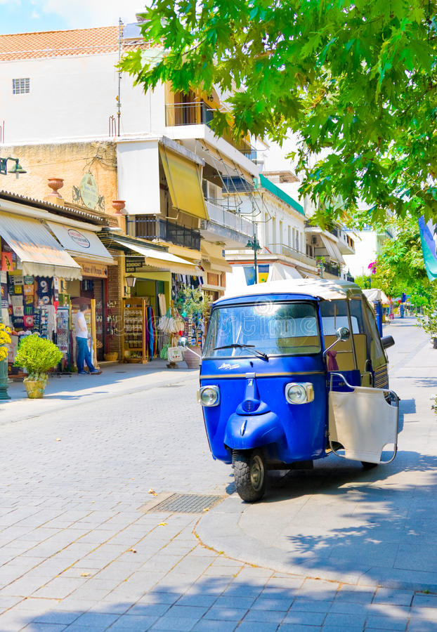 OLIMPIA, GREECE - JUNE 13, 2014: Tuk-Tuk in Olimpia, Greece on June 13, 2014.One of main attractions of Greece. OLIMPIA, GREECE - JUNE 13, 2014: Tuk-Tuk in stock photo