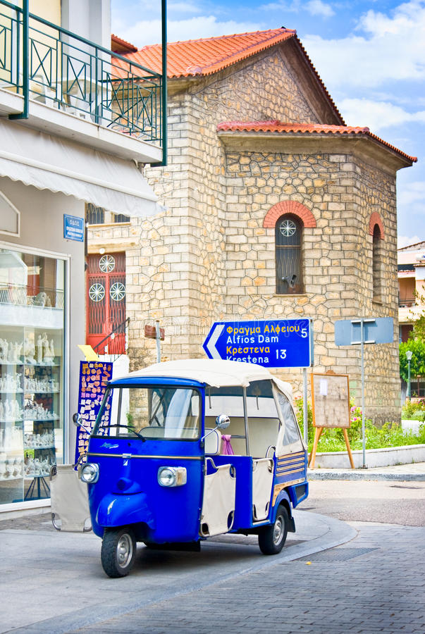OLIMPIA, GREECE - JUNE 13, 2014: Tuk-Tuk in Olimpia, Greece on June 13, 2014.One of the main attractions of Greece. OLIMPIA, GREECE - JUNE 13, 2014: Tuk-Tuk in stock photo