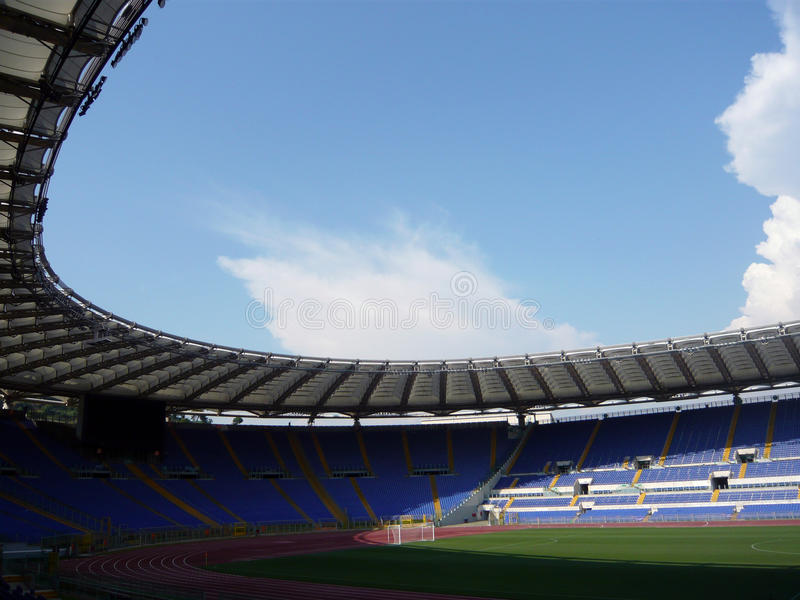 Olimpic stadium rome. Inside sight of the Olympic stadium in rome in the foreground the ground of game the footstep of athletics and the slopes royalty free stock photo