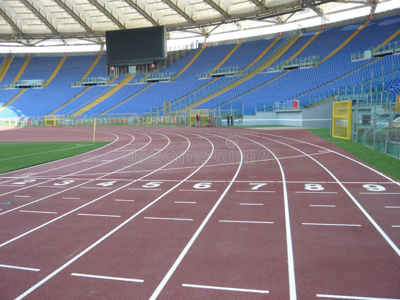 Olimpic stadium rome. Inside sight of the Olympic stadium in rome in the foreground the footstep of athletics and the slopes stock images