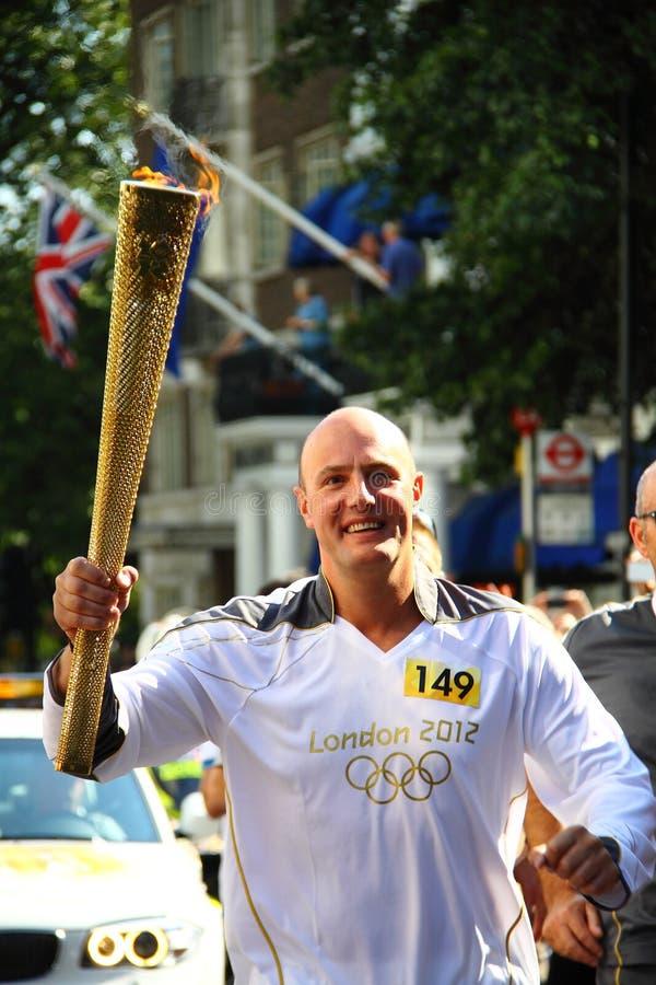 Olimpijski 2012 pochodni biegacz zdjęcia stock