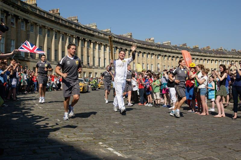Olimpijski pochodni luzowanie 2012, skąpanie, UK. fotografia stock