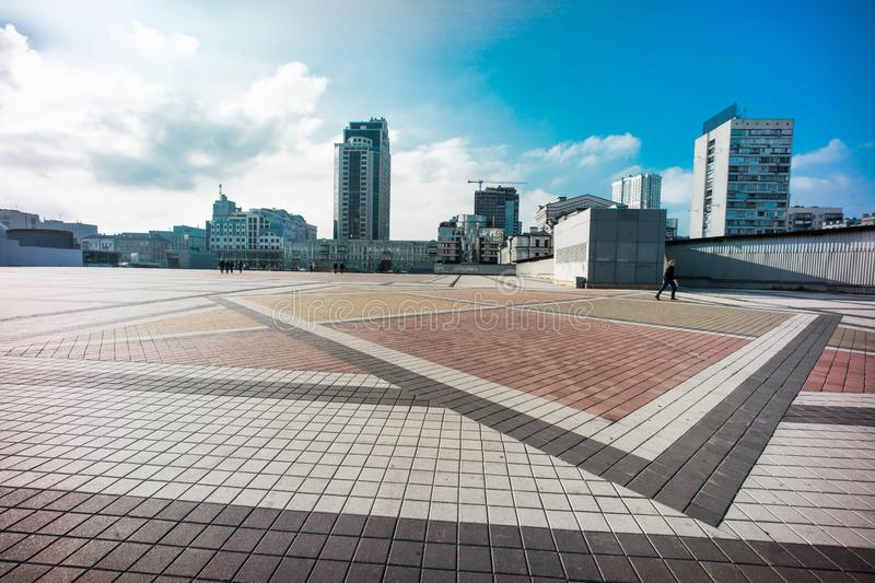 Olimpiyskiy square with paving stones and nobody on shot. With big dynamic range, blue sky and colorful space stock image