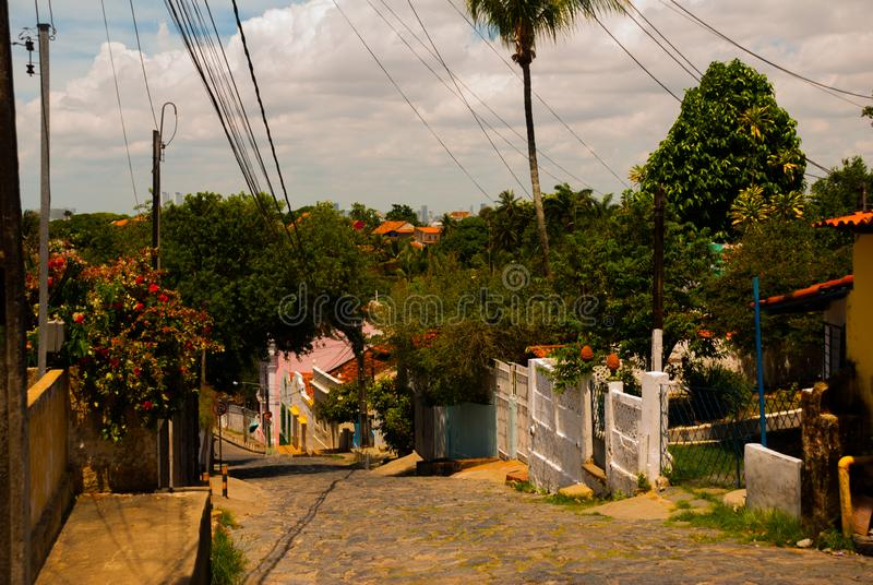 Olinda, Brazil: Cobbled street in historic Brazilian city Olinda with colonial architecture houses stock photography