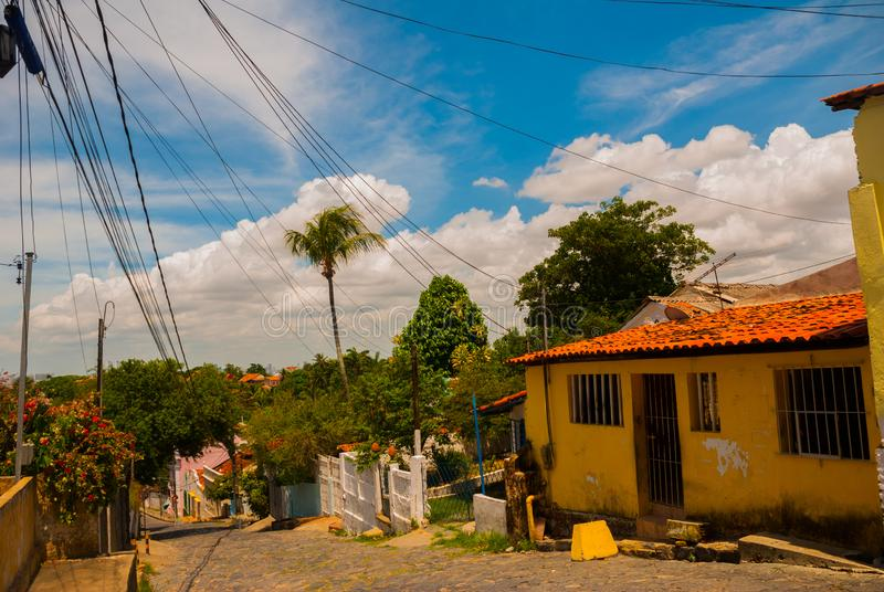 Olinda, Brazil: Cobbled street in historic Brazilian city Olinda with colonial architecture houses. Olinda, Pernambuco, Brazil: Cobbled street in historic stock photography