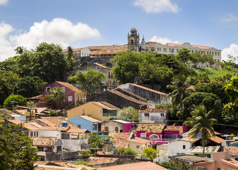 Olinda. Panoramic view of the city of Olinda in Pernambuco, Brazil showcasing its historic building dated from the 14th century among the exuberant foliage of royalty free stock image