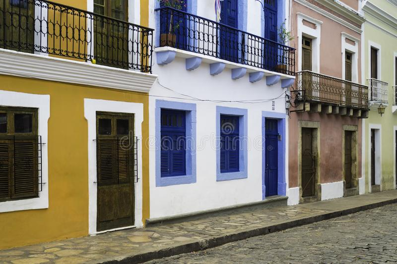 Olinda in Pernambuco, Brazil. View of the historic city of Olinda in Pernambuco, Brazil showcasing its colonial buildings and cobble stone streets at sunrise stock image
