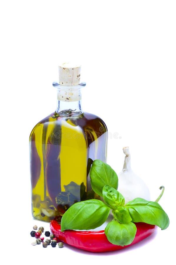 Olio di oliva infuso fotografia stock libera da diritti