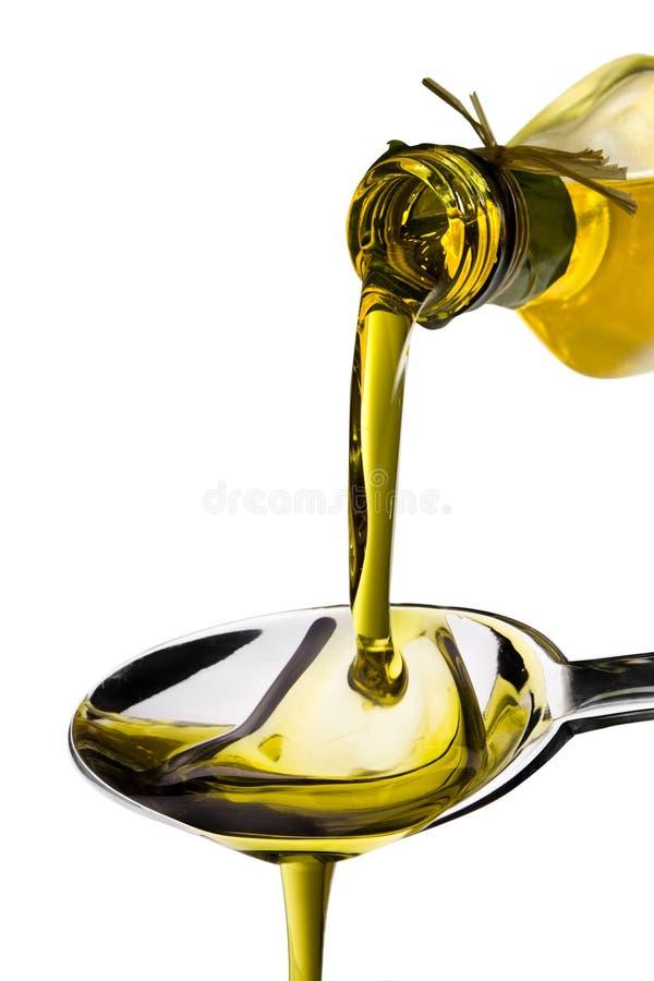 Olio di oliva versato fotografie stock