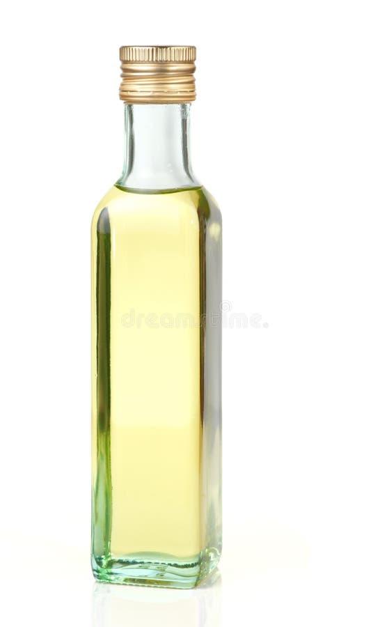 Olio di semi dell'uva in bottiglia di vetro, isolata fotografia stock