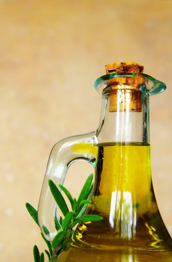 Olio e rosmarino di oliva immagini stock
