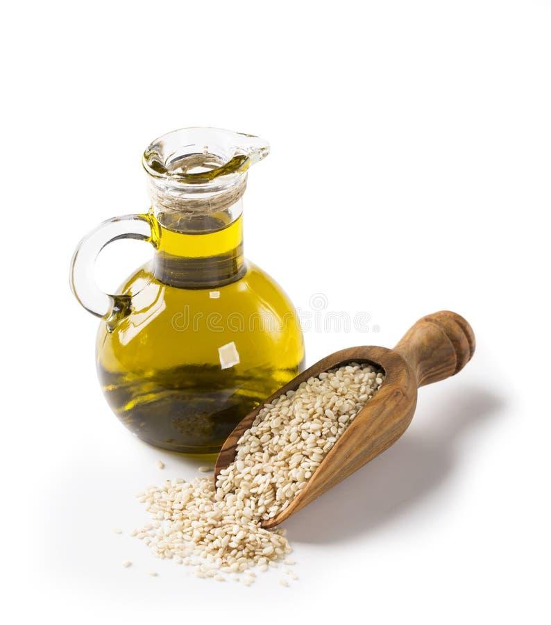 Olio e semi di sesamo immagini stock libere da diritti