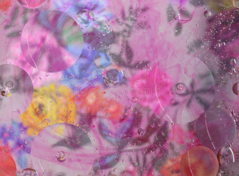 Olio floreale variopinto sul fondo dell'estratto dell'acqua fotografia stock libera da diritti